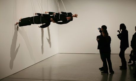 Rope trick … Trisha Brown's Walking on the Wall, re-created at the Barbican. Photograph: Martin Godwin for the Guardian