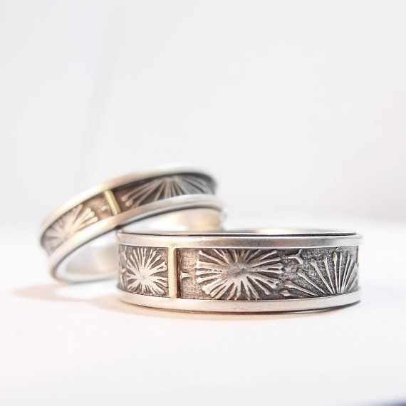 Each of these Dandelion rings is made almost entirely from sterling silver. Each sterling silver band is inlaid with a sterling ribbon patterned with a dandelion design. The design is finished with a 14k yellow gold tab and then each ring is lined with a sterling silver sleeve.