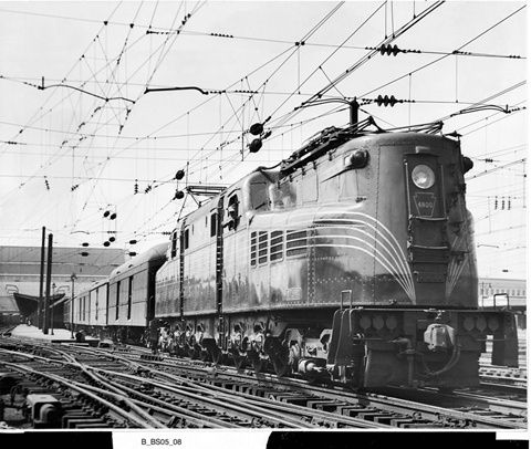 Wearing the widely spaced five-stripe livery designed by Raymond Loewy, the PRRs first GG1, No. 4800, is on the northbound Colonial at Washington Union Station in about 1935.