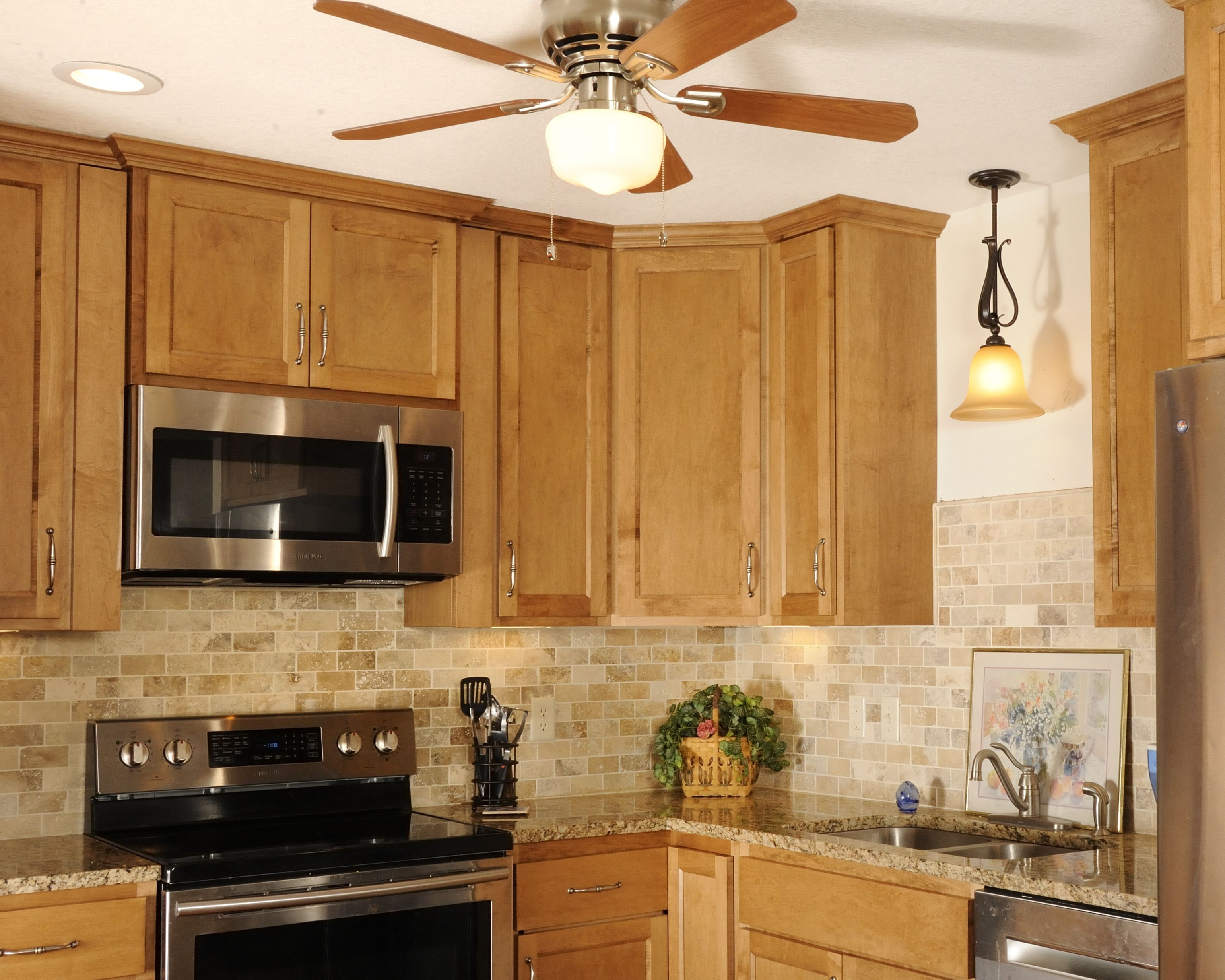 Honey Maple Finish With Natural Granite Counter Top And Travertine Back Splash All In Less Than 120 Sq Ft Maple Kitchen Cabinets Updated Kitchen Maple Kitchen