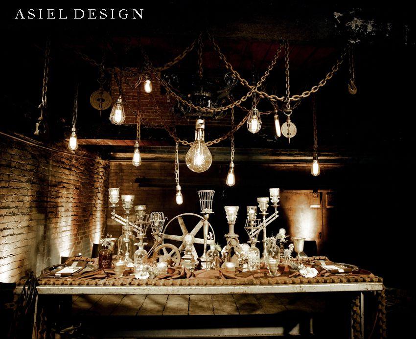 steampunk wedding dining table wooden wheels hanging light bulbs glass vials