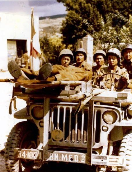 Medics Of The 100th Infantry Battalion Composed Japanese Americans Use A Jeep As An Ambulance Vehicle During Fighting In Italy