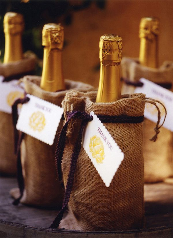 Burlap bags used for table favors with custom tag. We think this would make  great escort cards!