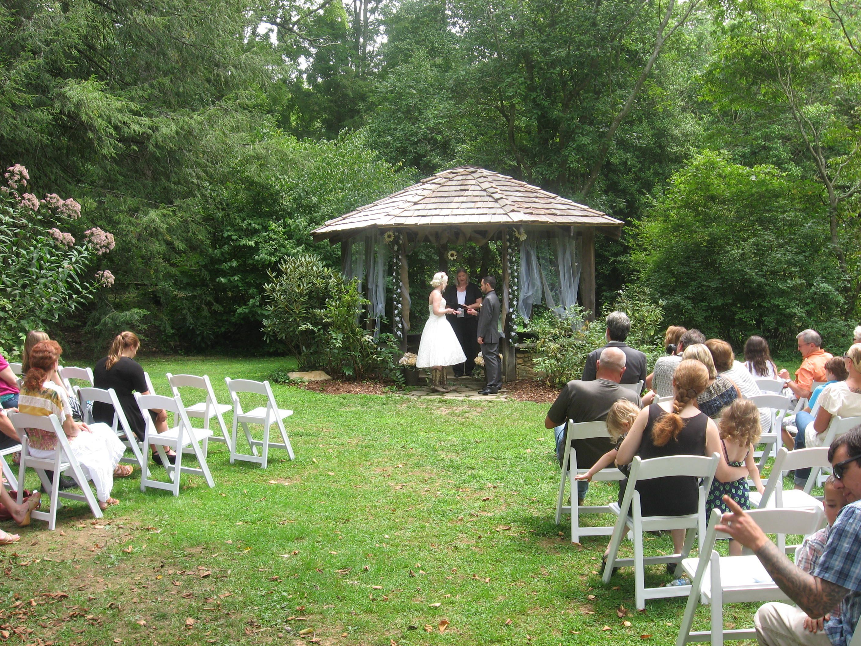 a summer wedding in the gazebo at the asheville botanical gardens