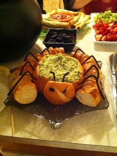 halloween mummy spinach dip | spinach dip in a bread bowl, add pipe cleaner legs…