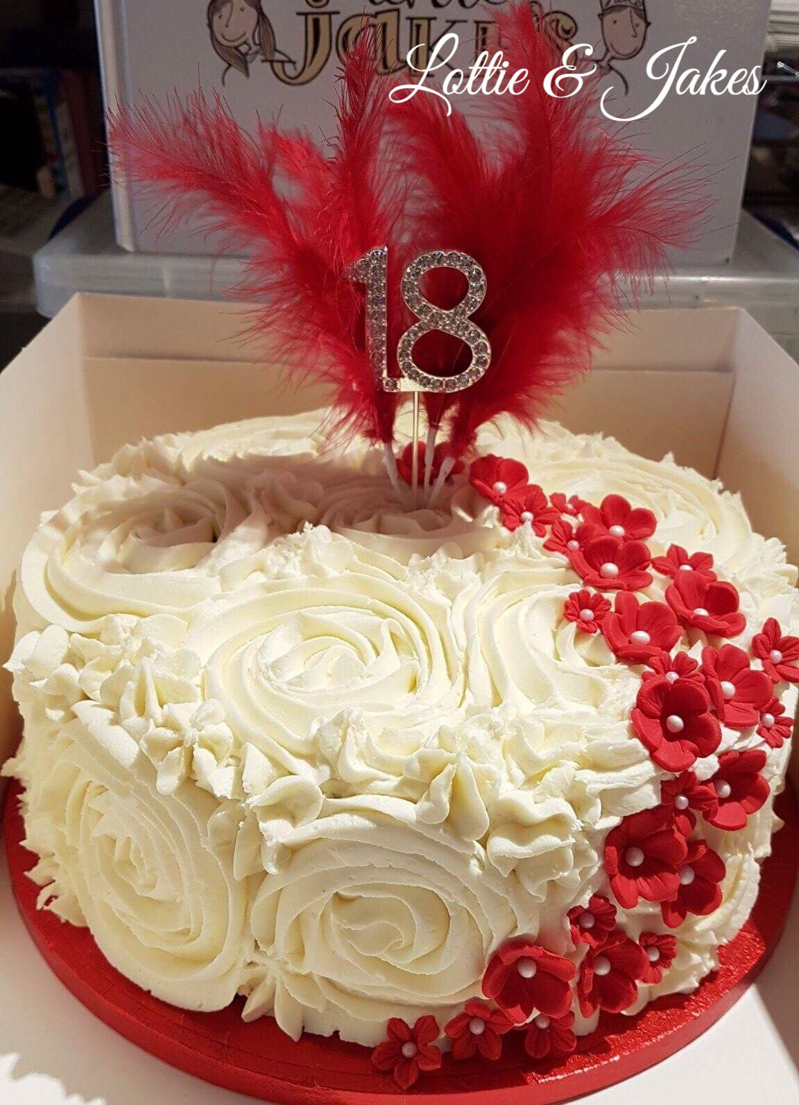 Fabulous 18th Birthday Cake with cute red flowers and