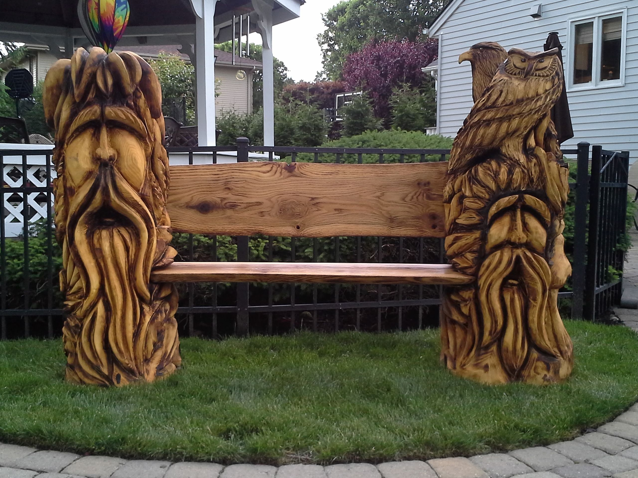 Chainsaw carved benches wood spirit