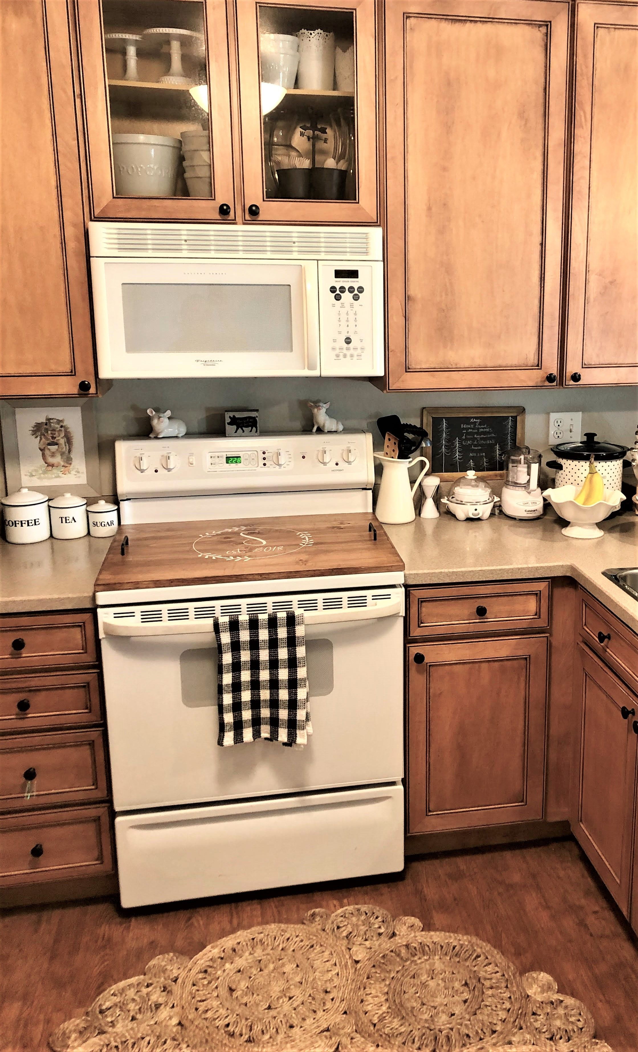 Oak Stove Top Cover In 2020 Country Kitchen Cabinets Stained Kitchen Cabinets Kitchen Cabinets Decor