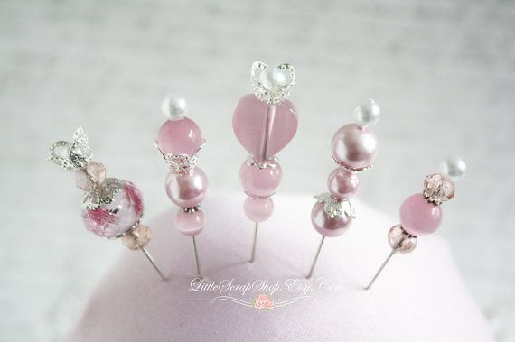 Stick pins are the new trend in scrapbooking. Add these beautiful treasures to your pages or cards.  Youll receive 5 pins in a handmade Matchbook. The matchbook is embellished with pretty little roses. Rose color will vary.  Each Pin Measures appx. 2 inches  The matchbook is made from a heavy pattern paper. The pins are stuck into foam. Made with glass beads
