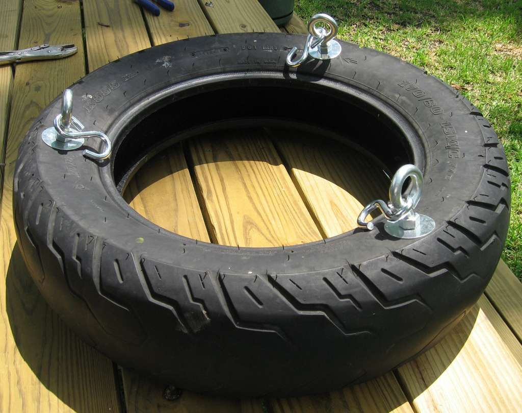How to make a tire swing on the side diy tire swing for Diy tire