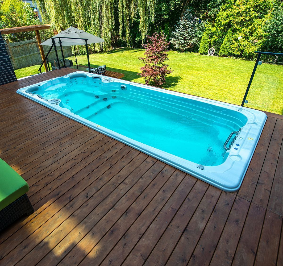 Installing Your Swim Spa Into A Deck Can Give You An Inground Pool Look For Significantly Less Than An Inground Swim Spa Landscaping Backyard Pool Endless Pool