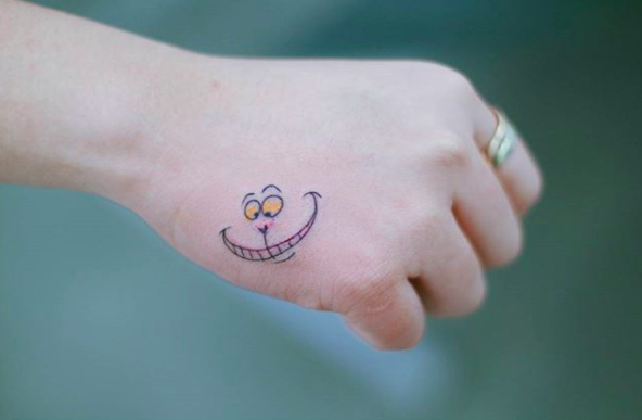 Celebrate The Sassiest Kitty Of All Time Disney Tattoos Cheshire Cat Tattoo Small Tattoos