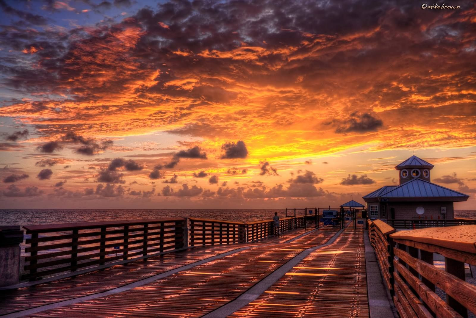 Enjoy this beautiful sunrise at the Juno Beach Pier in Florida. (Photo Credit: Photography By Mike Brown)