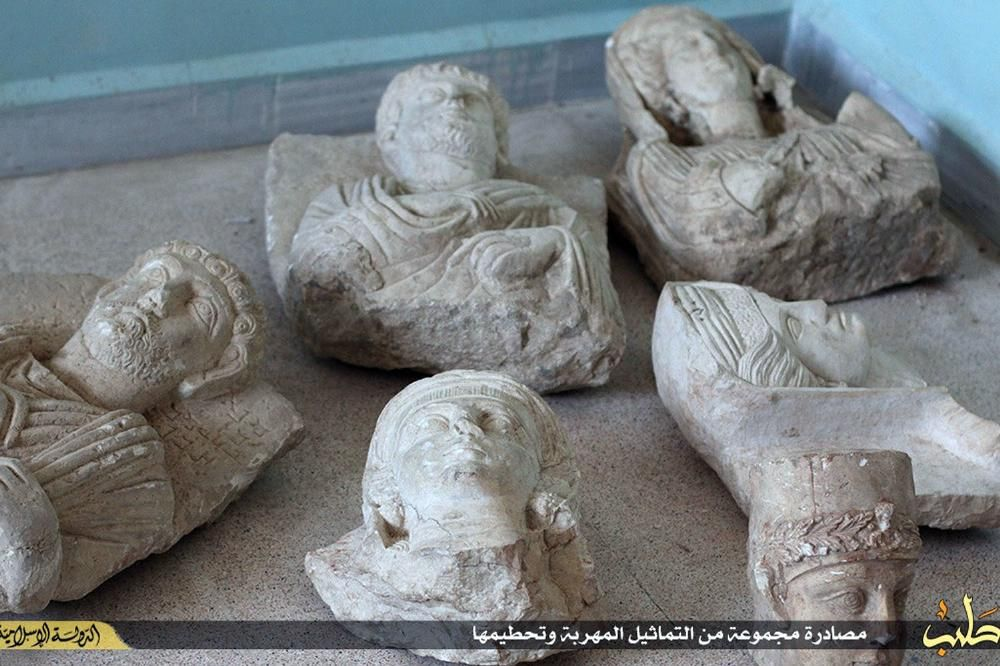 Islamic State Posts Photos of Militants Taking Sledgehammer to Ancient Artifacts from Palmyra, Syria | VICE News
