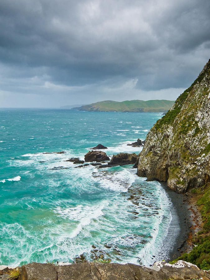 ✮ Cliffs under thunder clouds and turquoise ocean