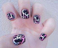 That's it, I need to buy some black crackle nail polish so I can try this. These nails look like the scratch art I made in elementary school, and that was awesome.