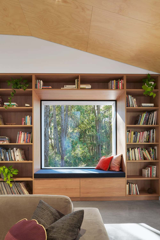 Compact pavilion house surrounded by dense Australian bushland