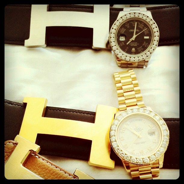 H buckle Hermes Belts matched up with a pair of Rolex Day Date watches with iced out bezels.