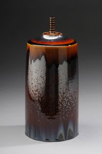 Jar with Iron Crystalline glase Description: High fire porcelain, Wheel thrownFired 20 hours. Cone 10 Dimensions: H:15.00 x W:6.00 x D:6...