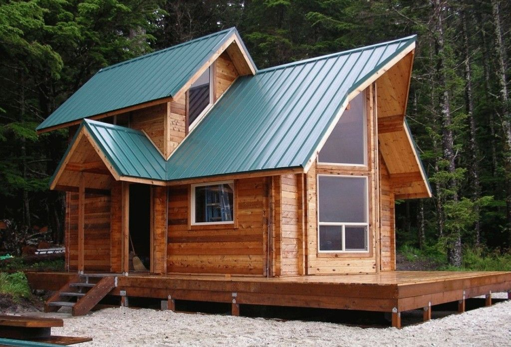 Tiny house kits for sale a unique roof design with many for Unique log cabin designs