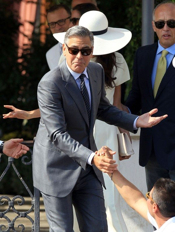George Clooney and Amal Alamuddin visit the Town Hall in Venice, Italy ... he is such a ham!
