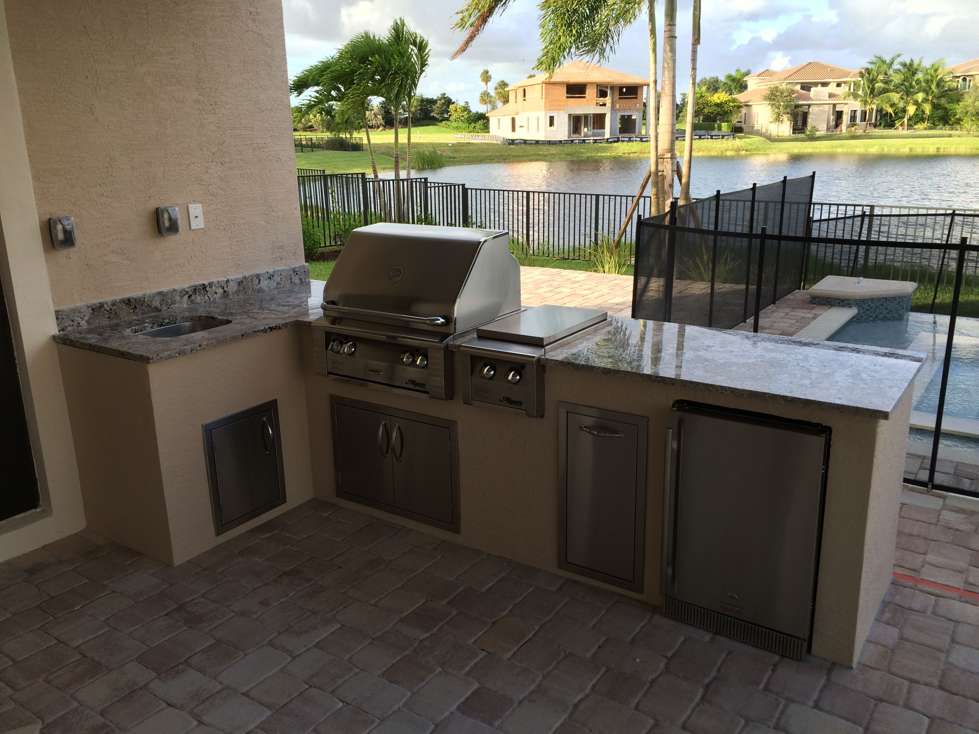 L shaped outdoor kitchen with alfresco