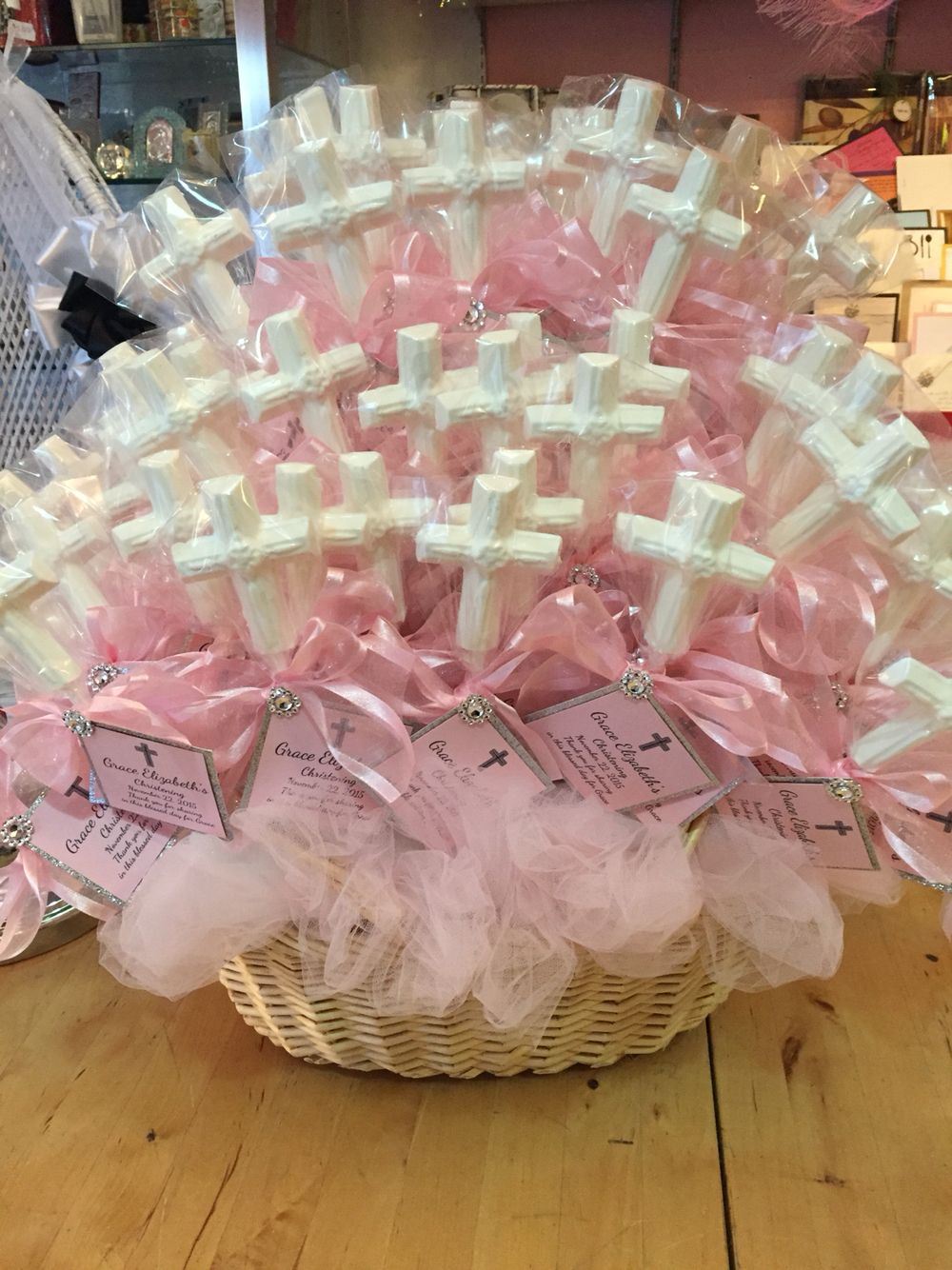White chocolate cross favors pink and white for baby girl for Baby girl baptism decoration ideas