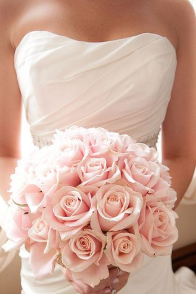 Roses are still the most popular wedding flower. http://bit.ly/1kYAQfS