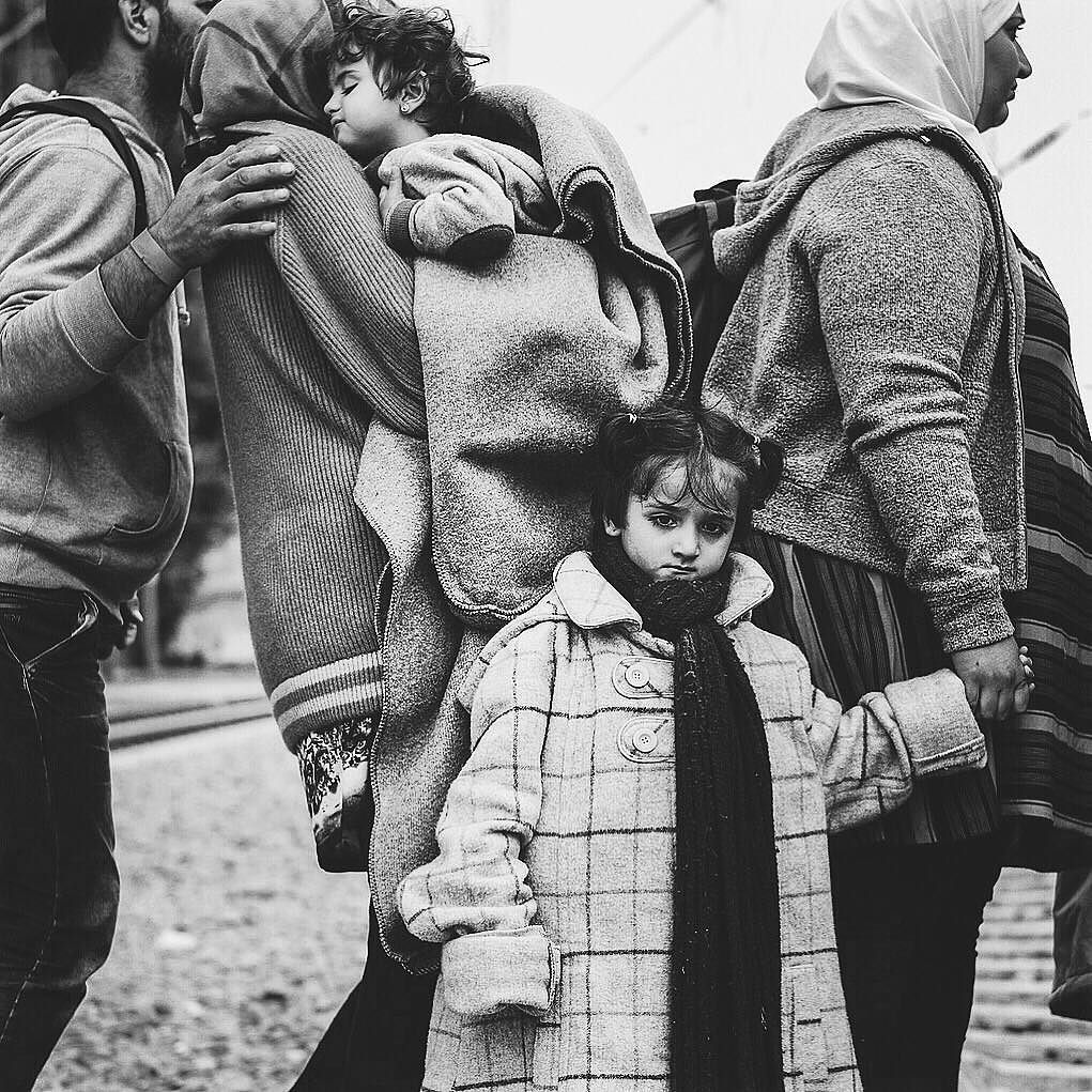 Photo by @ciriljazbec / Refugee crisis in Europe. Families are exhausted after a long journey from Syria. Taken in Tovarnik at Croatia-Serbia border. Here a mother is holding her child and waiting to be boarded on a train to Hungary. They are hoping to reach Northern Europe. More than 70000 refugees and migrants arrived until last Sunday in Croatia. Follow more at @ciriljazbec @natgeo #refugeecrisis #migrantcrisis #Europe by natgeo