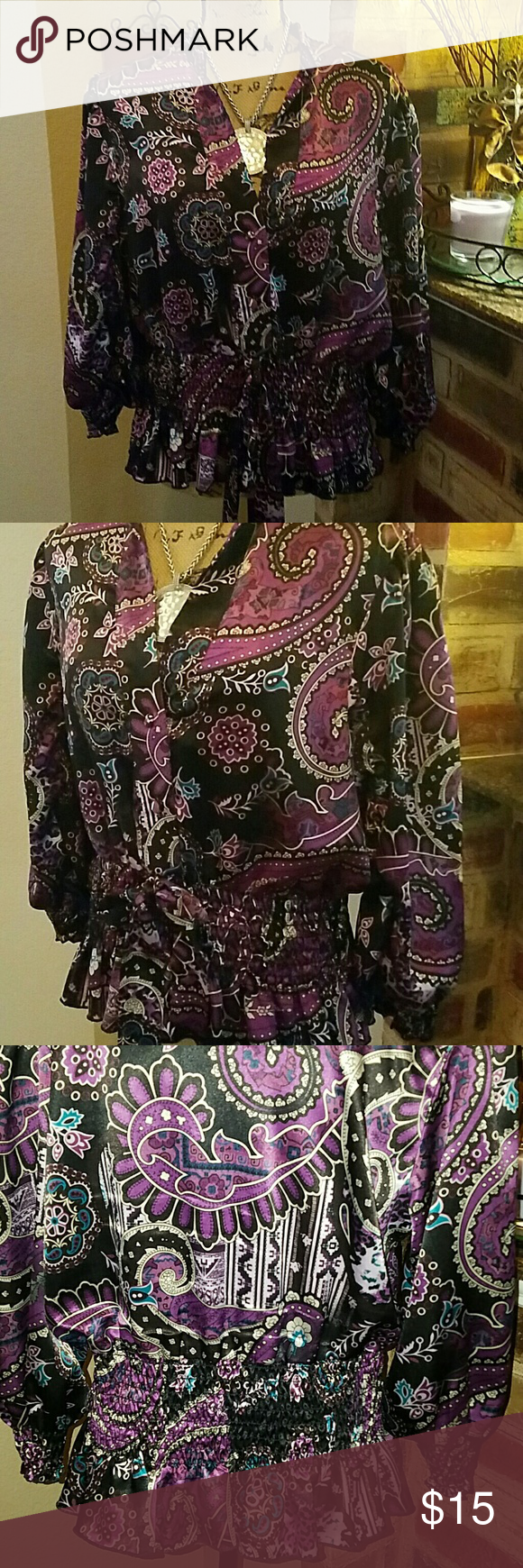 Beautiful Boho chic style top This is a beautiful vintage boho floral print top. It's gathers and has elastic at the hip area with a ruffled flare. The arms also have a gathered elastic at the cuff. It is 100% polyester and in excellent excellent condition. Great for fall with a black skirt or a pair of black slacks! Design works  Tops Blouses