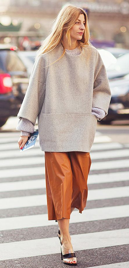 Taupe sweater tunic paired with caramel color trousers