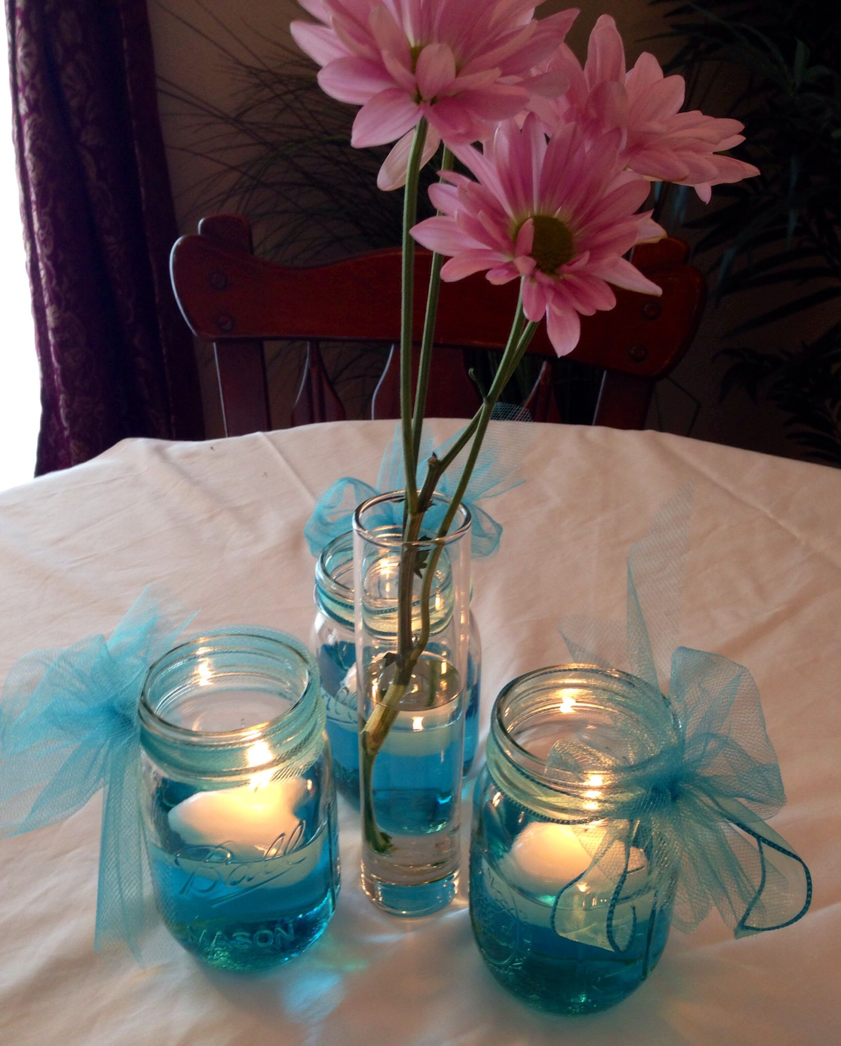 church wedding decorations candles%0A Wedding or baby shower table decorations  Mason jar with filled with water     drop food coloring  floating candle  u     ribbon  Bud vase with daisies