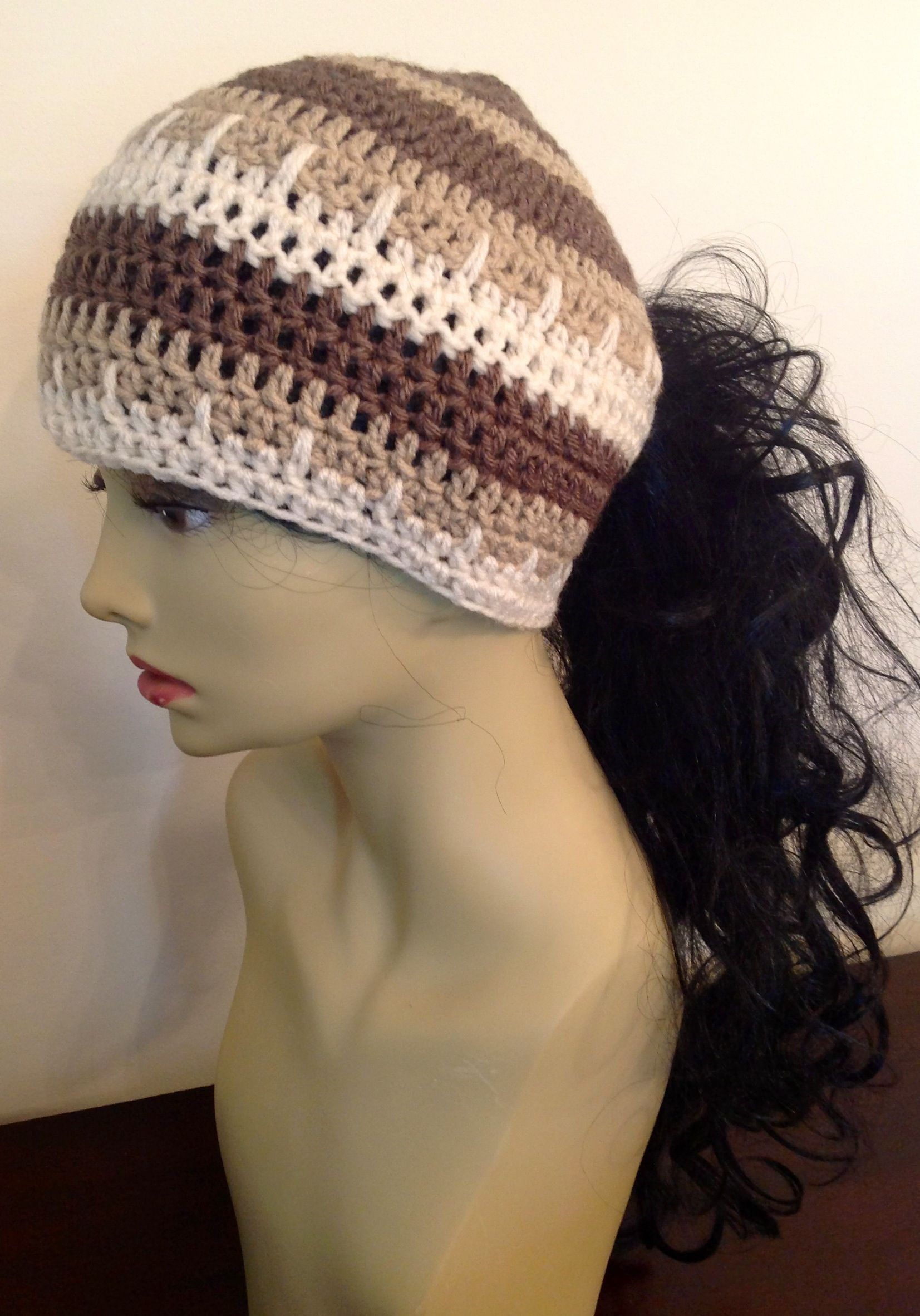 Crochet ponytail hat. I wonder if I can figure this out with no pattern  15894df6f83
