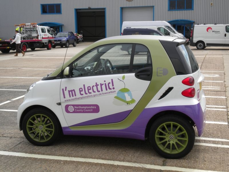 Partial #wrap of smart car - interesting \ playful #sign solution - car resume examples