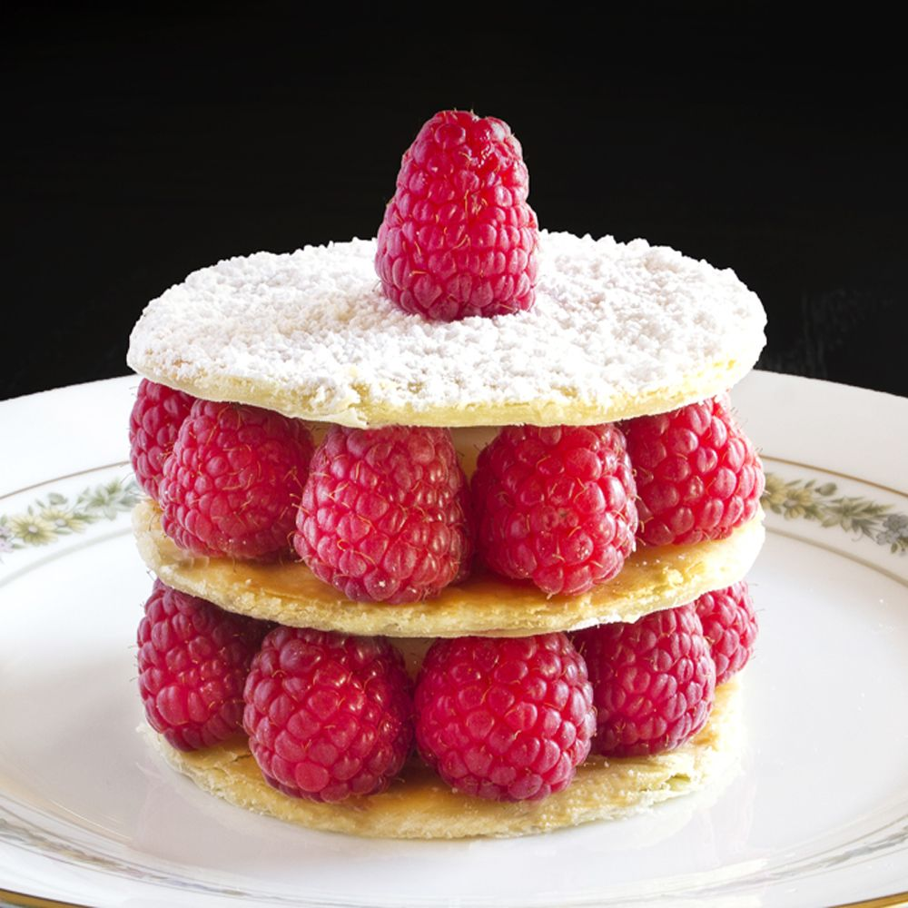 Raspberry Millefeuille.  Flaky pastry with a buttery crunch,  velvety smooth vanilla custard,  sweet/tart raspberries. A perfect contrast in textures and flavors.