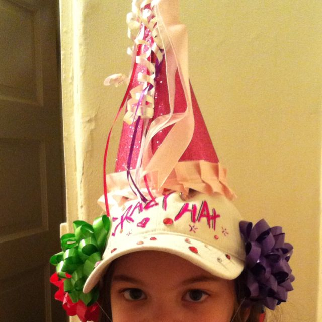 CRAZY HAT DAY:: Baseball hat with bows stapled around the sides and a birthday hat on top. Just to clarify, we wrote 'crazy hat' on it and added some bling. #crazyhatdayideas