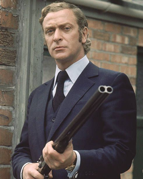 British actor Michael Caine toting a shotgun on the set of 'Get Carter', circa 1971.