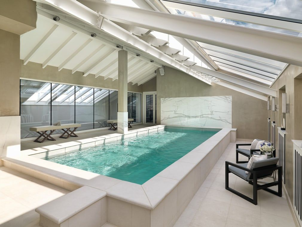 opulent design retractable roof. The private swimming pool in the luxury Kensington penthouse includes a  retractable glass roof London with ceiling POOLS