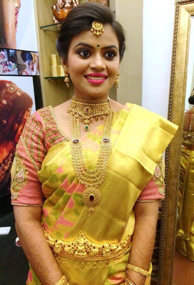 Traditional Southern Indian bride wearing bridal hair, saree and ...