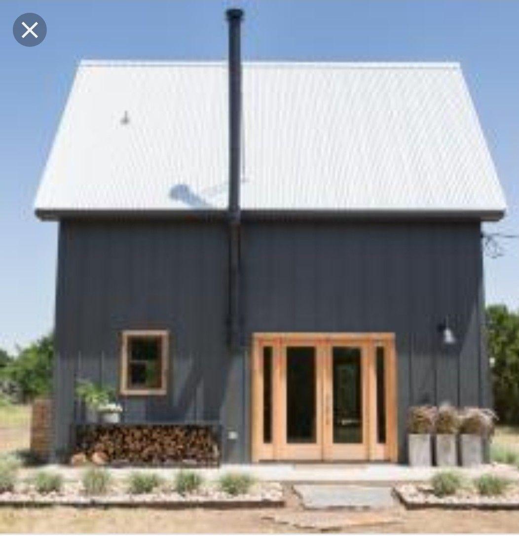 Color scheme exterior dark blue, steel, and raw wood