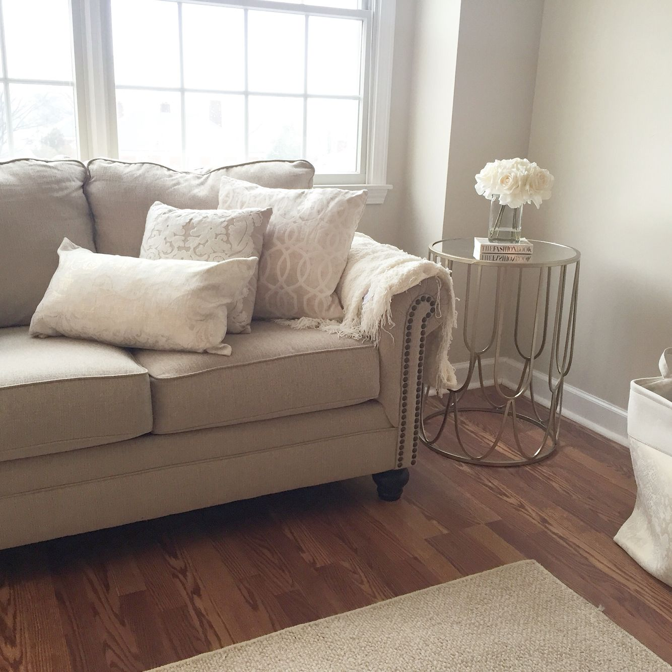 Cozy living room warm beige and whites paint color calico cream sherwin williams milari sofa - Small space sectional couches paint ...