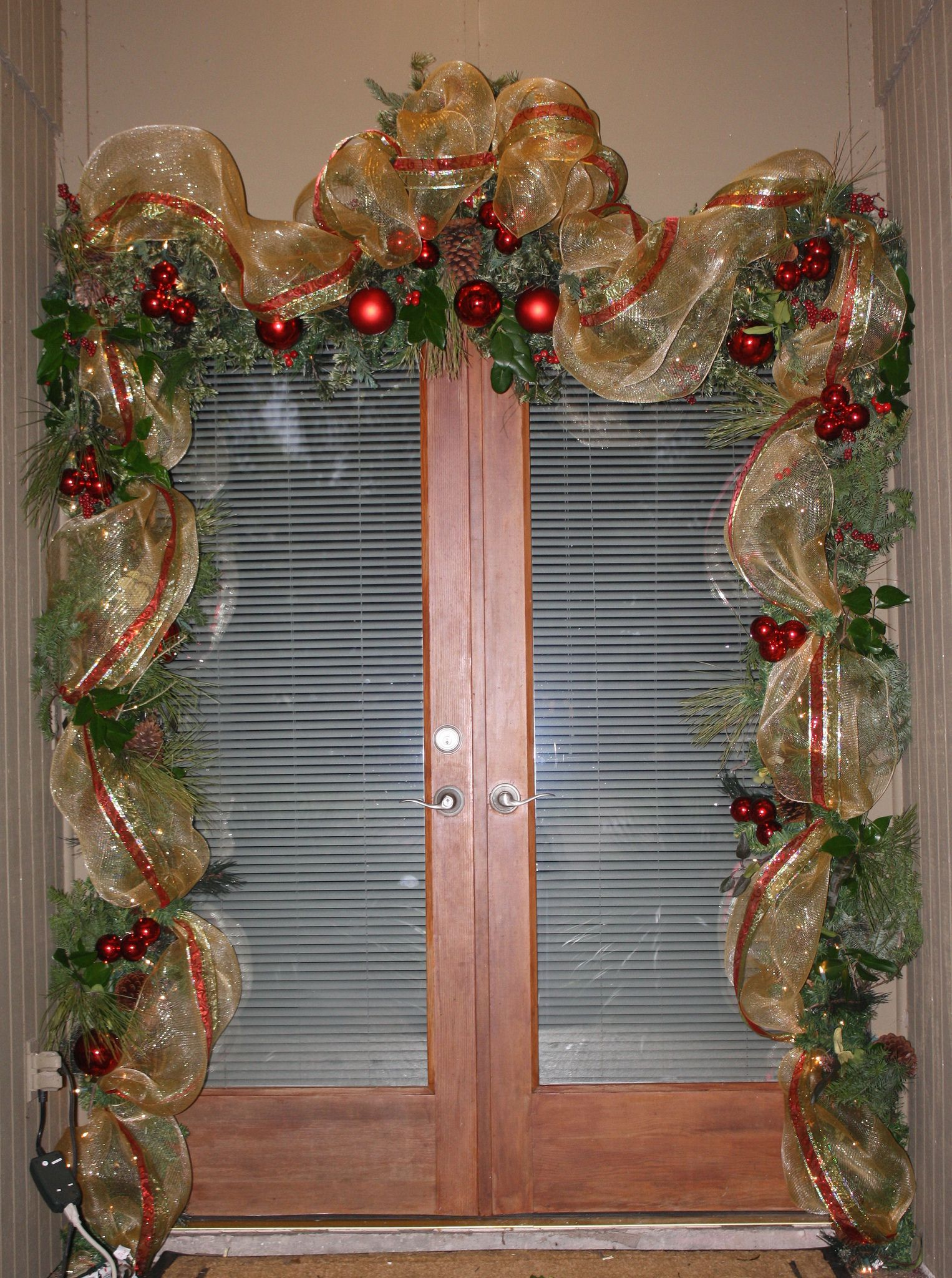 Front Door Garland Using 21 Deco Mesh And Wired Ribbon And Tucking In Some Fresh Greenery Christmas Diy Christmas Swags Christmas Door Decorations
