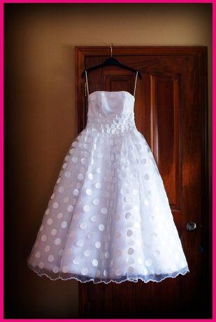 White on white polka dot wedding dress.
