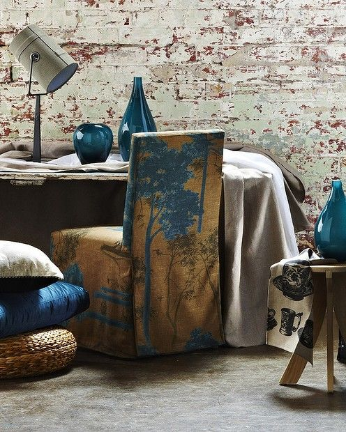 I love the printed chair cover.  Teal retreat. Styled by Ruth Welsby.