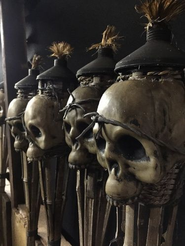 Dollar Store skulls + tiki torch makeover~these are fantastic