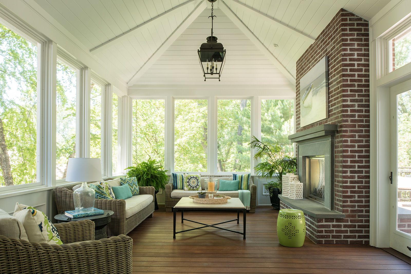 Screened In Porch Vaulted Ceiling With A Brick Fire Place Would Paint The Brick White But Love This Room Overall Coastal Living Rooms House With Porch Home