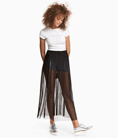 b78b853eb Black. H&M LOVES COACHELLA. Long skirt in pleated mesh with an elasticized  waistband. Unlined. Made from recycled polyester.