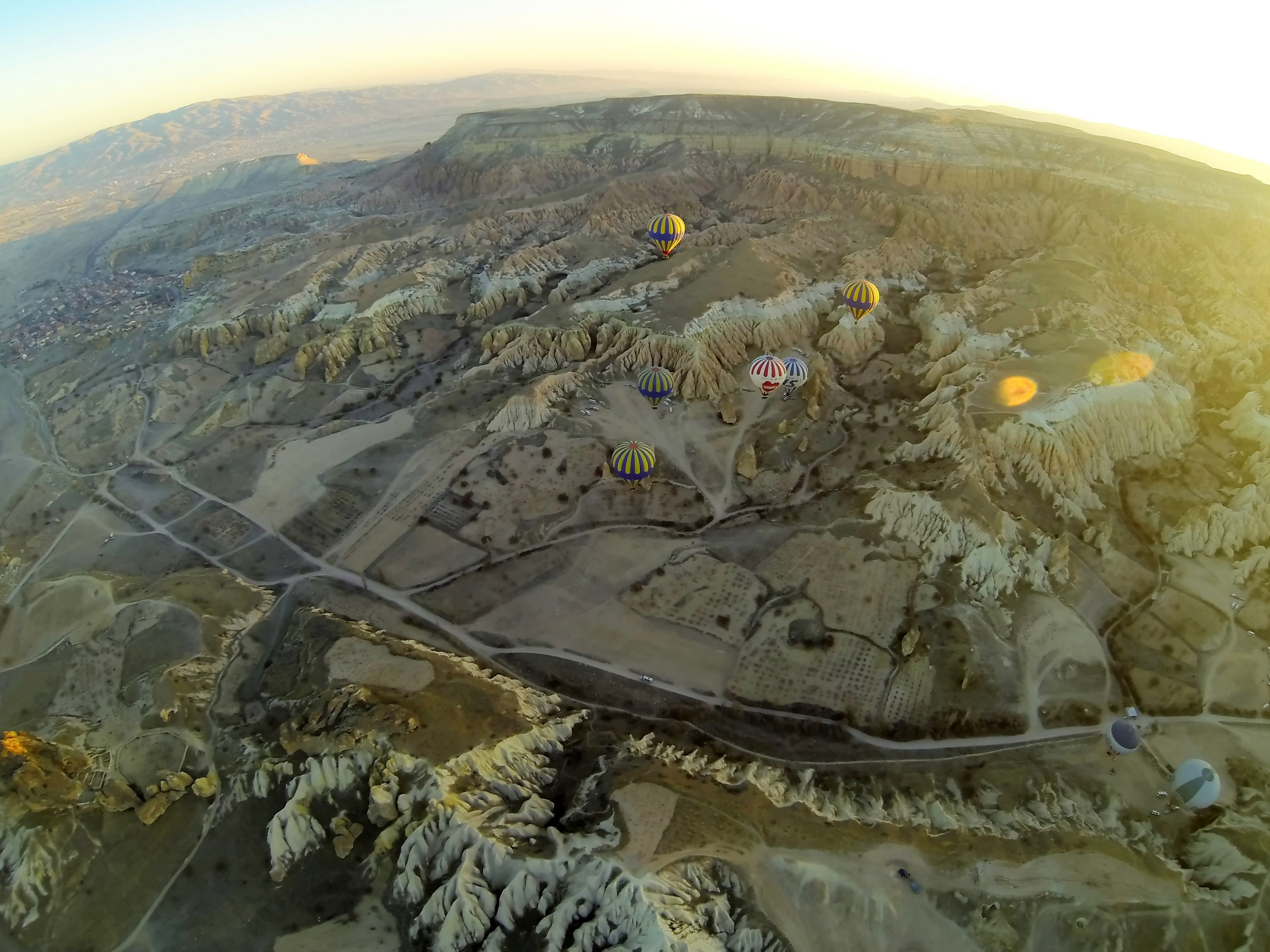 Image from https://upload.wikimedia.org/wikipedia/commons/a/a0/Aerial_view_of_Cappadocia_from_hot_air_balloon_9279_Compressor_rot3.jpg.