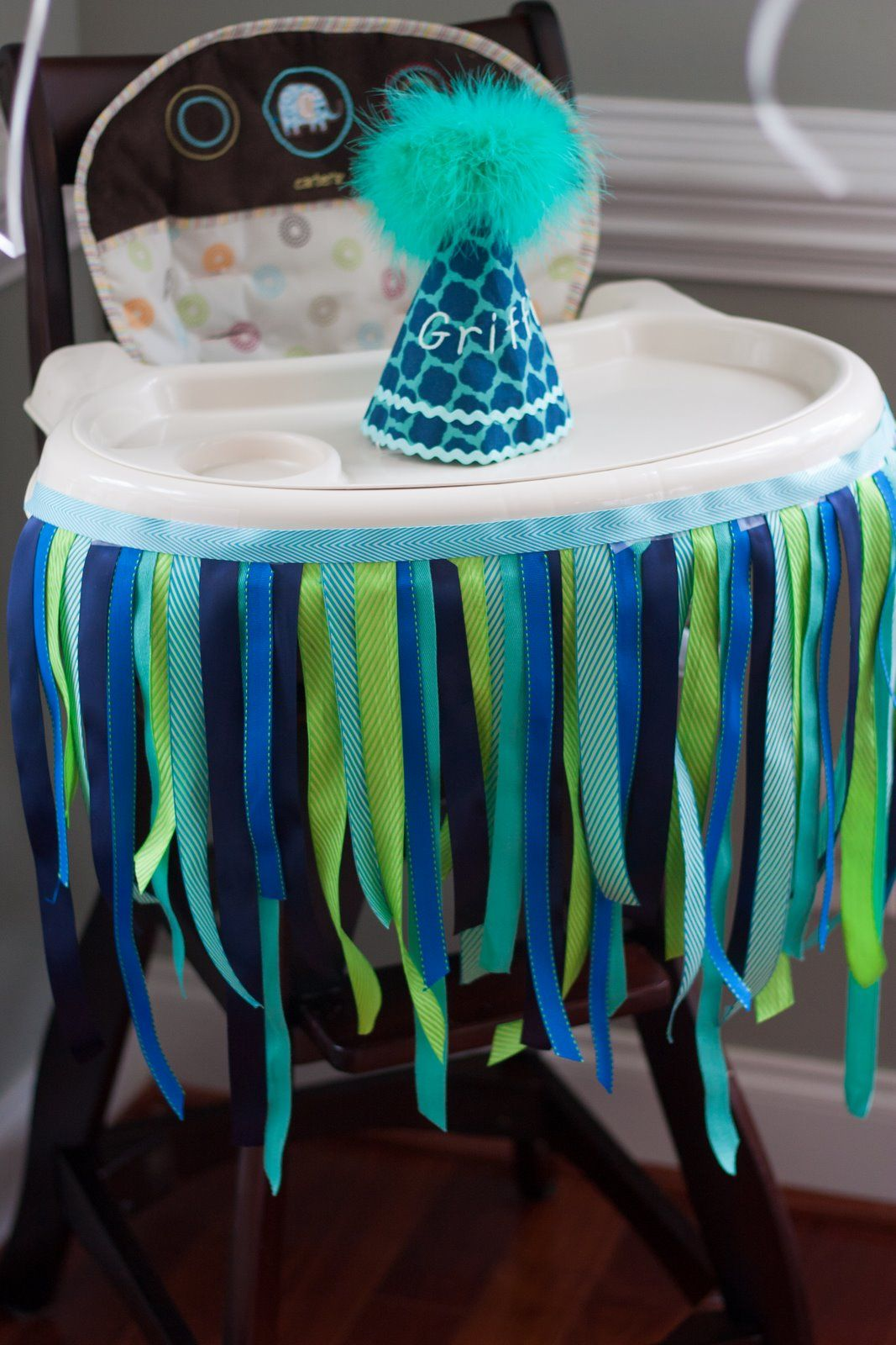 Decorated High Chair With Ribbon And Custom Birthday Party Hat