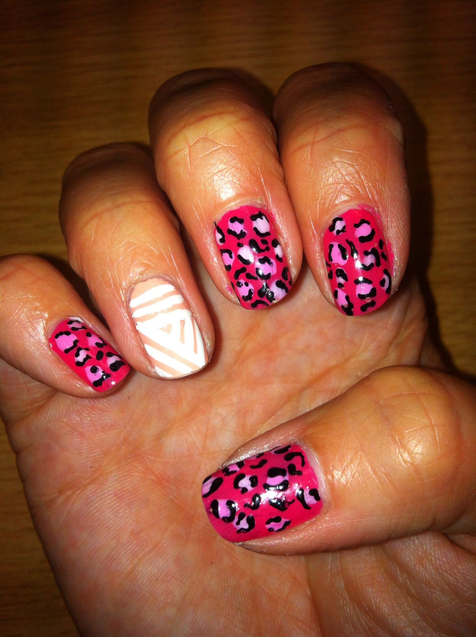 Hot pink leopard & peach & white basket case nails....